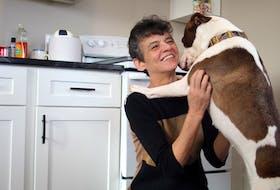 Lisa Legere and her dog, Sarah, enjoying their new house.