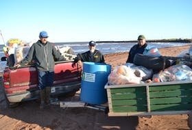 Roseville/Miminegash Watersheds Association Inc. workers, from left, Milton Chaisson, Thane Doucette and Danny Murphy display the debris their September beach sweep netted.