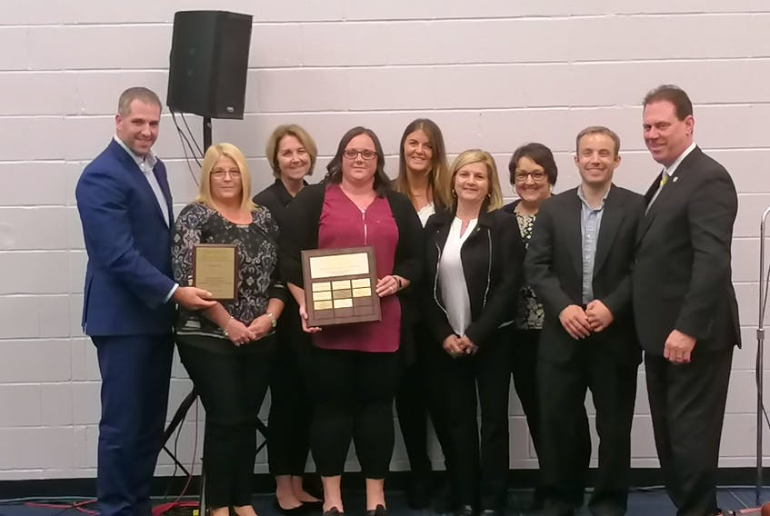 Health Minister James Aylward, right, congratulates members of Western Hospital's tele-rounding team on earning Health P.E.I.'s 2019 Leadership Excellence in Quality and Safety Award. In attendance at the Health P.E.I. annual meeting to receive the award on behalf of the team were, from left, Paul Young, administrator of community hospitals west; Bev Ashley, emergency room clinical lead; Angela Carragher, physiotherapy/occupational therapy; Stephanie Gaudet, in-patient clinical lead; Laura Haywood, administrative assistant; Sue LaPierre, director of nursing; Gloria Waite, admissions supervisor and Andrew Ramsay, support services manager.