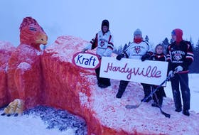 Members of the Hardy family, from left, Bradley Hardy, Janet Hardy Callaghan, Emma Hardy and Landon Bulger pose with their Kraft Hardyville sculpture they helped create for the Tyne Valley Winter Carnivals snow sculpture competition. The design stems from the idea of a phoenix rising from the ashes.