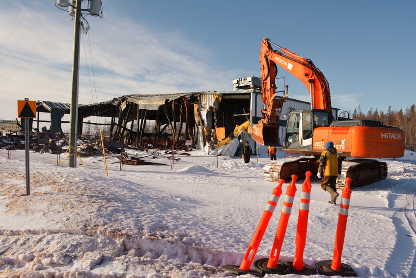 Demolition equipment moved onto the site Wednesday to start dismantling what's left of the Tyne Valley rink following the Dec. 29 fire. A project committee is hoping to have construction started on a new arena this year.