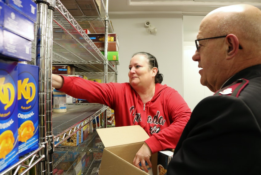 Darlene MacDonald, manager of the Summerside Salvation Army Food Bank, gets help from Major Wayne Green to fill a Christmas Hamper. Millicent McKay/Journal Pioneer