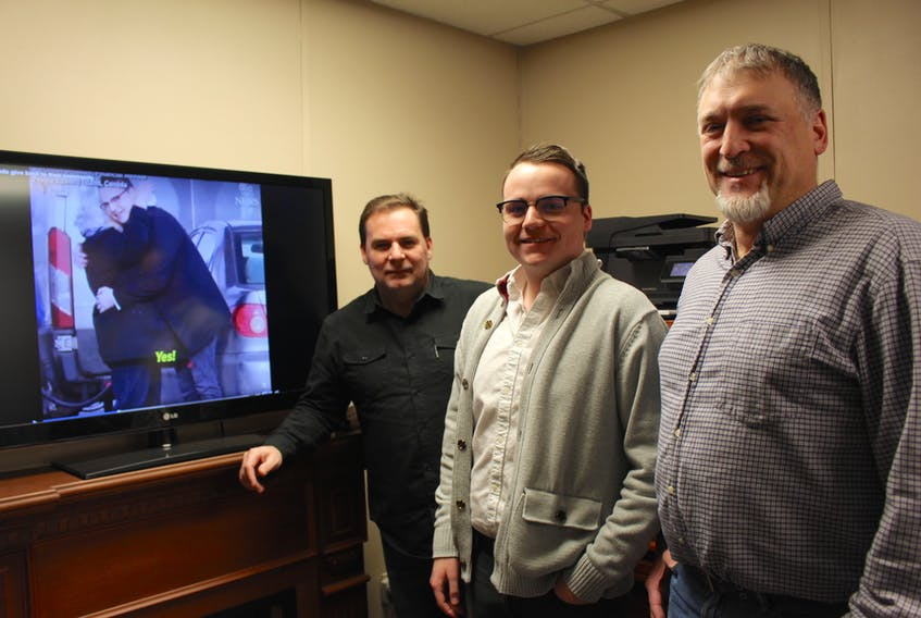 Jeff MacLellan, left, Logan MacLellan and Sean Deagle recently participated in a pay it forward initiative put on by M & N Investments. To capture the moment, a team of videographers made a video of people's reactions.