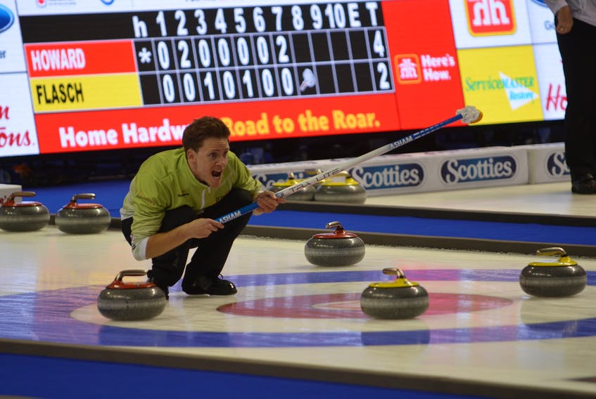 Skip Adam Casey yells instructions to his sweepers during Thursday's game against Jamie Murphy at the 2017 Home Hardware Road to the Roar Pre-Trials curling event in Summerside. Murphy won the game 9-5. Jason Simmonds/Journal Pioneer