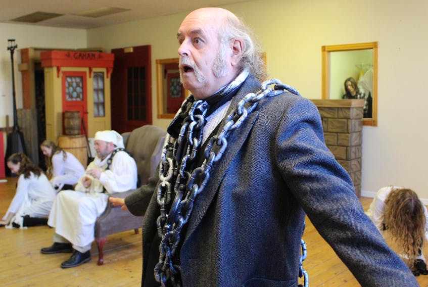 """Peter Surkan, centre, dawned his chains as Jacob Marley during a rehearsal of the song """"Link by Link"""" for the upcoming Fandango Musical Productions Inc. musical """"A Christmas Carol."""""""