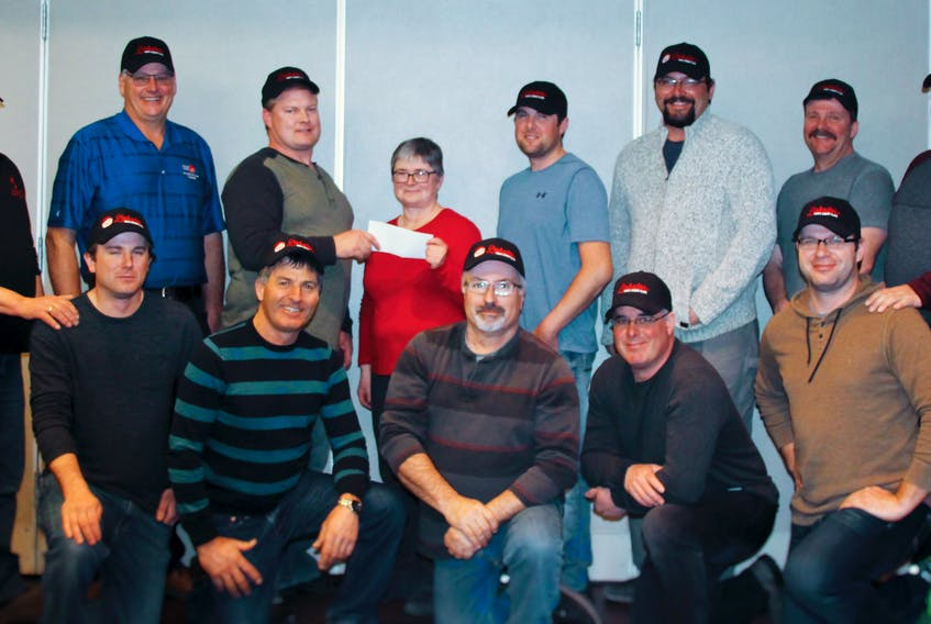 Marlene Campbell, Cultural Programming Coordinator with Culture Summerside – Summerside Lobster Festival Inc., attended a recent meeting of the Lobster Fishers of Prince Edward Island Board for the official launch of the presenting sponsorship. Back row, from left: Robert (Bobby) Jenkins (PEIFA, ex-officio), Craig Avery, Charlie McGeoghegan, Marlene Campbell, Ryan Peters, Brodie Creed, Ken LeClair, Wayne Campbell. Front row (left to right): Tyler Pickering, Lee Knox, Kevin Robertson, Stephen MacPhee, and Malcolm Ferguson