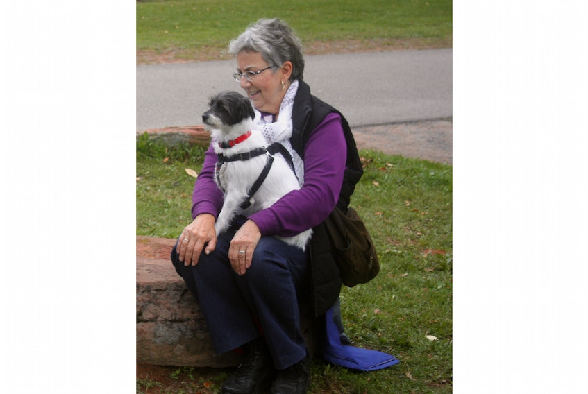 Joan Atkinson, who adopted Pippy through ElderDog, enjoys Pawd in the Park in 2017. - File