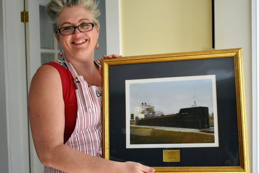 """Ceilidh Barnett was presented with this picture, """"In recognition of her exemplary service on the Canadian Olympic,"""" on Nov. 22, 2009. The ship is one of the many she sailed on during her seven-year career as a cook."""