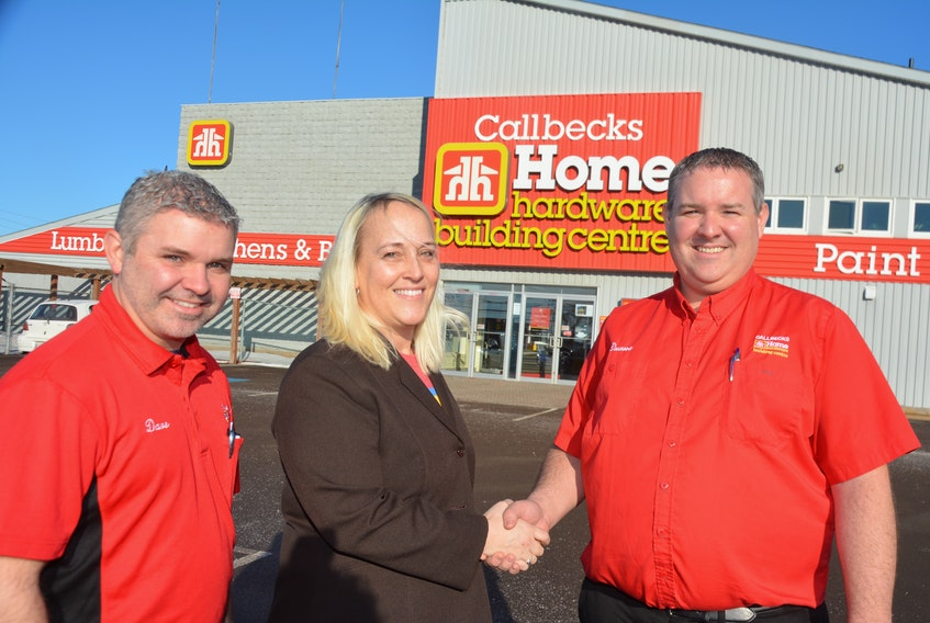 Dave and Duane MacDonald, left and right, co-owners of Callbecks Home Hardware and Summerside Home Furniture, with Lori Ellis, of Culture Summerside. Callbecks has signed up to be the title sponsor of this year's Summerside Lobster Carnival Parade.