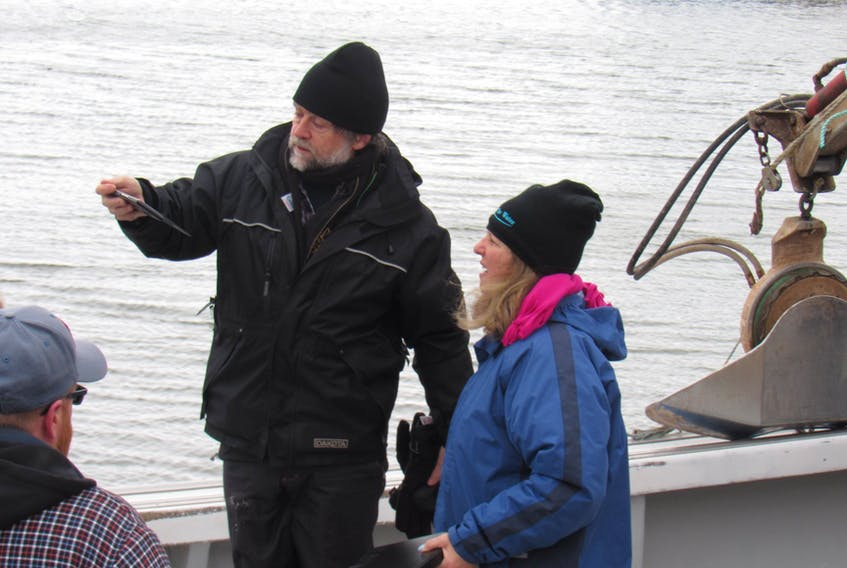 SUBMITTED PHOTOS BY EDITH COLE Cinematographer Christopher Ball and Island filmmaker Susan Rodgers discuss a shot during a recent shoot at Malpeque Bay.