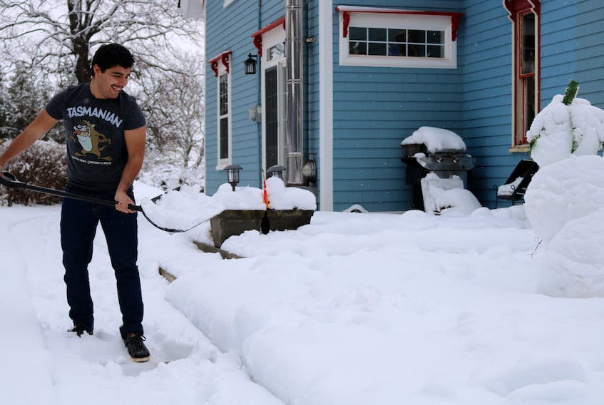 Ramón Velasco Alfonzo gets an authentic Canadian experience: shovelling snow.