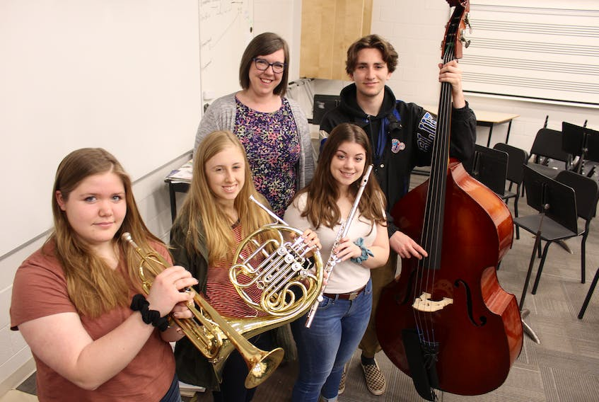 The Three Oaks Senior High wind ensemble recently took home a gold standard at the prestigious MusicFest Canada event in Ottawa. TOSH Music teacher Krista Bryson, rear, with her students, from left, Brianna Underhill, Carly MacKenzie, Bekah Jones and Marcus Gauthier.
