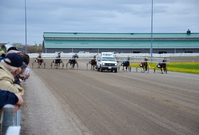 The starting gate approaches the start during a recent harness racing card at Red Shores at Summerside Raceway.