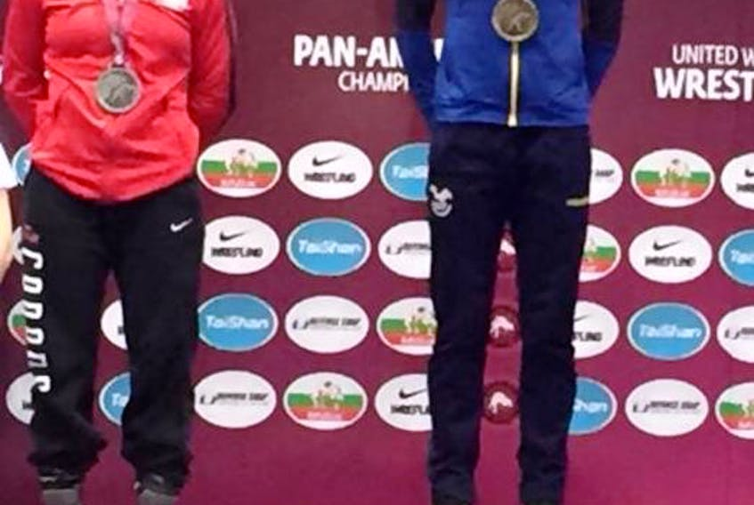 Silver-medallist Hannah Taylor, left, and gold-medallist Lissette Antes Castillo of Ecuador on the podium at the recent Pan American senior wrestling championships in Buenos Aires, Argentina.