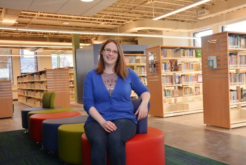 Rebecca Boulter, literacy and public services librarian at the Summerside Inspire Learning Centre, and a team of volunteers from the Friends of the Library and Rotary Club of Summerside were busy Wednesday getting ready for the new facility's opening, Thursday.