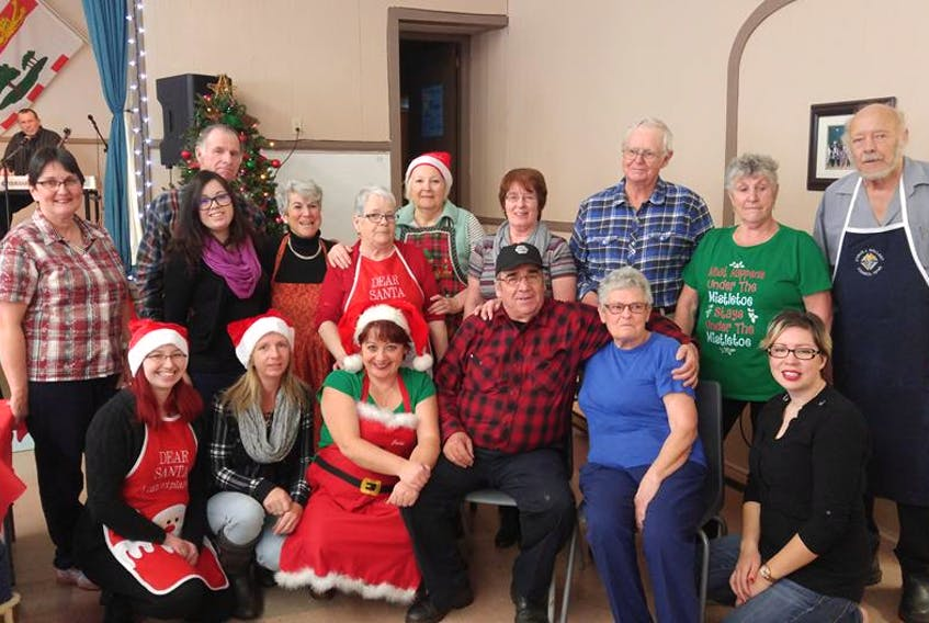 Musicians and other volunteers take timeout for a photo during the Christmas dinner, which was moved to Boxing Day this year, at St. Anthony's Hall in Woodstock.