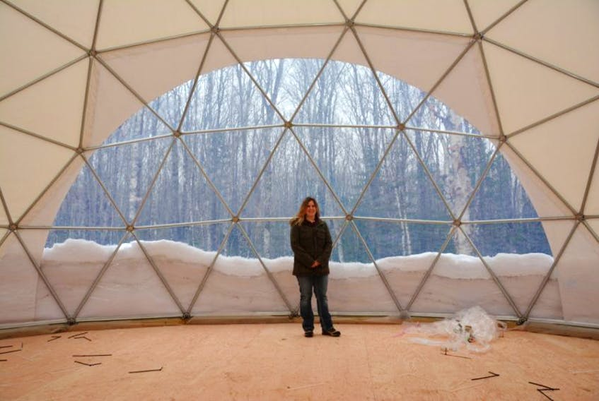 Sheila Arsenault, owner and soon-to-be operator of Treetop Haven in Mount Tryon, stands inside one of the geodesic domes she is building to house visitors this summer.