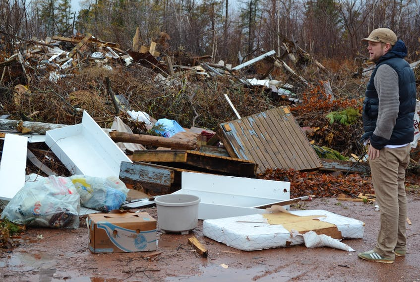 Councillor Joey Dumville surveys the garbage that litters a Town of O'Leary property that ceased to be an active dump 15 years ago.