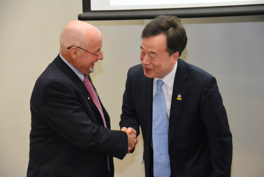 Summerside Mayor Bill Martin shakes hands with Steve Cho, president of Samsung Renewable Energy, during an announcement at Credit Union Place Thursday.