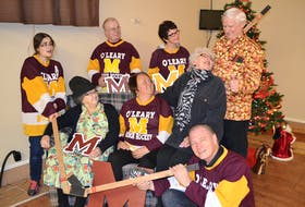 Dale Howard, right, gives a Don Cherry-like pep talk to fellow cast members of O'Leary Town Players Christmas in Hockeyille Dinner Theatre.