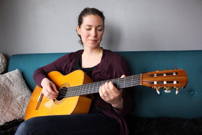 Catherine MacLellan plays one of her dad's guitars. MacLellan is the daughter of famous Canadian musician, Gene MacLellan.