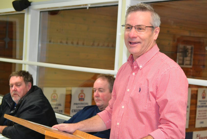 Agriculture and Fisheries Minister Robert Henderson, speaking during the annual meeting of the Western Gulf Fishermen's Association. Looking on are WGFA president Francis Morrissey, left, and director Lloyd Phillips.