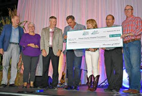 Warren Ellis, from left, Paula Biggar, Robert Henderson, Robert Mitchell, Tina Mundy, Sonny Gallant, and Chris Palmer donate a whopping $1 million to the PCH foundation on behalf of the province.