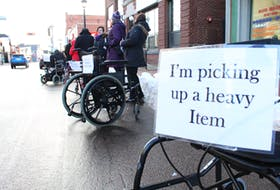 P.E.I. Council of People with Disabilities staged a silent protest in downtown Summerside Monday in recognition of the International Day of Disabled Persons. The event was designed to bring awareness of the abuse of blue designated parking spaces by blocking regular parking spaces with wheelchairs and walkers.
