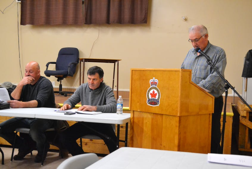 Prince County Fishermen;s Association vice-president Shelton Barlow speaking during the organization's annual meeting Monday at O'Leary Legion. Looking on are treasurer Michael Myers, left, and president Lee Knox.