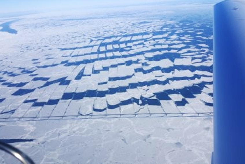 A photo from 7,500 feet above the Confederation Bridge shows the bridge piers shredding ice, and the wind and tide action then breaking the strips into big rectangles.- Photo by Paul Tymstra, Sea Eagle Aviation