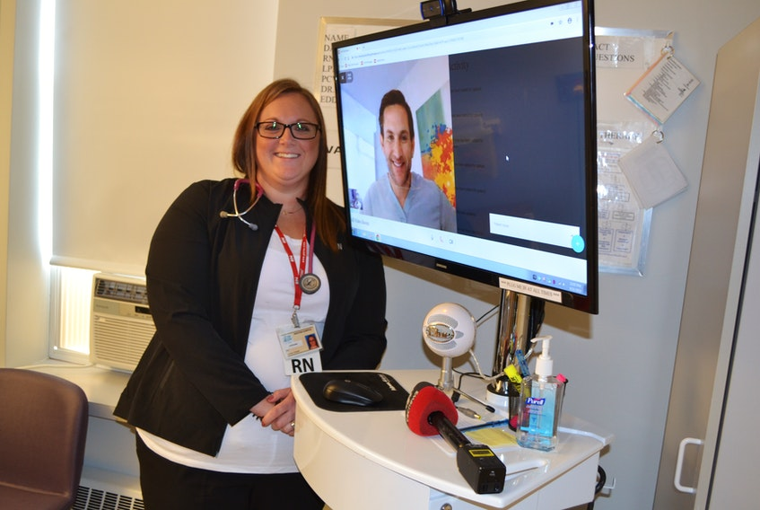 Nurse Stephanie Gaudet, at Western Hospital and Dr. Brett Belchetz, on the video monitor, CEO of Maple, an Ontario-based telemedicine company, explain how tele-rounding works. Western Hospital in Alberton is the first hospital in Canada to pilot tele-rounding.