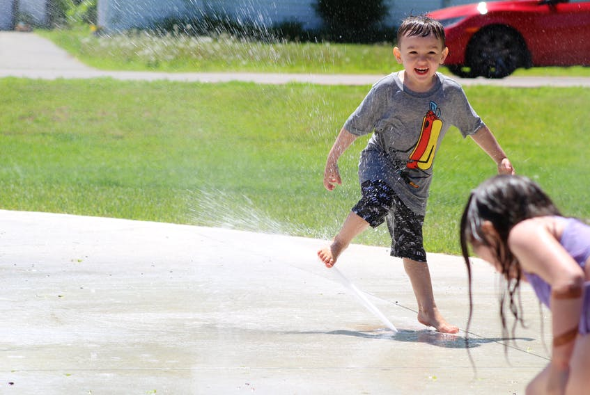 Clay Parsons, 3, beat the heat recently by playing with other kids at the City of Summerside's waterpark in Leger Park. The water play area is now open for the season and there is now a washroom and concessions stand available to park users.