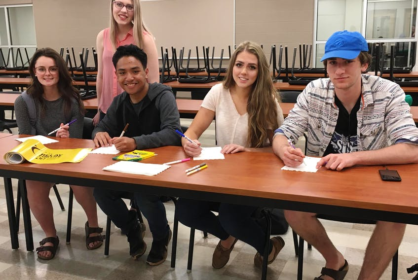 Executive planning board members of the Three Oaks Relay for Life event, Erin Arsenault-Gallant (left), Jadyn Gallant, Miko Moraleto, Maggie Costain, and Marcus Gauthier, label luminaries that will be displayed at the youth relay on Friday. This is the third annual relay event for the Summerside high school. The 2019 installation will run from 12 to 9 p.m. on May 31 at Three Oaks Senior High. The school hopes to raise $11,000 for cancer research. Those interested in participating in the Survivor's lap contact Jane Doyle at jado1644@cloud.edu.pe.ca. To purchase a luminary for $5 contact beccap@hotmail.ca or call the school at 902-888-8460. To donate, visit the school's main office, open Monday to Friday from 8 a.m. to 4 p.m., drop into the event (bus parking lot) or pledge students for the event. Online donations are also accepted. For more information email organizers at toshrelay2019@gmail.com.