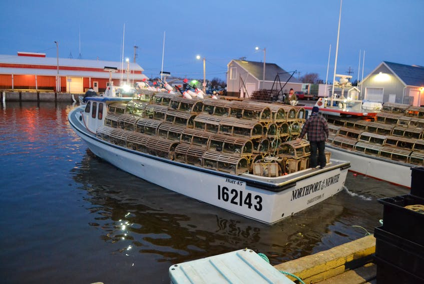 A fishing boat leaves the wharf in Northport Friday morning with its first load of lobster traps.  After four delays due to wind, the spring lobster season got underway i call conditions under a clear sky.