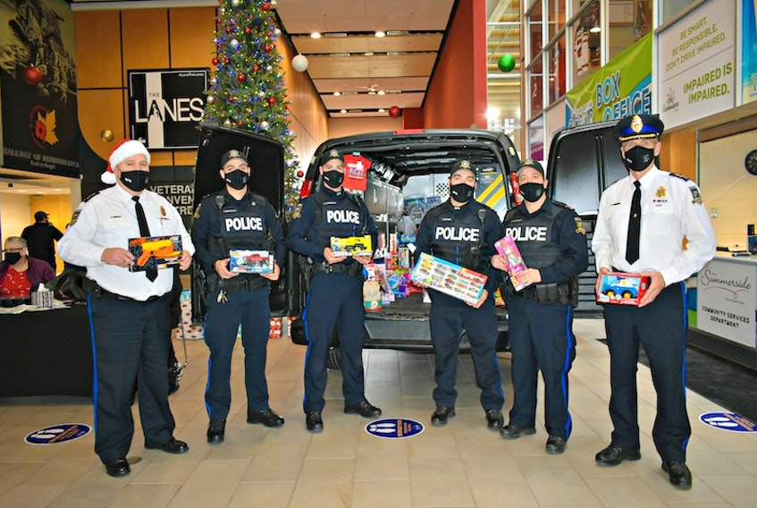 Summerside Police Services' Chief Dave Poirier, from left, Const. John Arsenault, Const. Colby Landrigan, Const. Jesse McCabe, Const. Gino Scichilone, and Deputy Chief Sinclair Walker took part in the recent Cops for Christmas Toy Drive in Summerside.