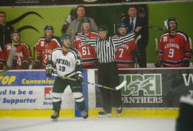 Tanner Doiron waves off an off-side during Saturday night's Atlantic University Sport men's hockey game between the UPEI Panthers and Acadia Axemen at the Bell Aliant Centre. Doiron has been selected to work games as a linesman for the World Under-17 Hockey Challenge from Nov. 3 to 10 in Saint John and Quispamsis, N.B.