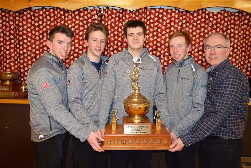 Skip Alex MacFadyen, from left, James Dalton, mate; Leslie Noye, second stone; Parker MacFadyen, lead, and coach David MacFadyen from the Silver Fox in Summerside won the team's first Pepsi P.E.I. junior men's curling championship at the Maple Leaf Curling Club in O'Leary on Friday night.
