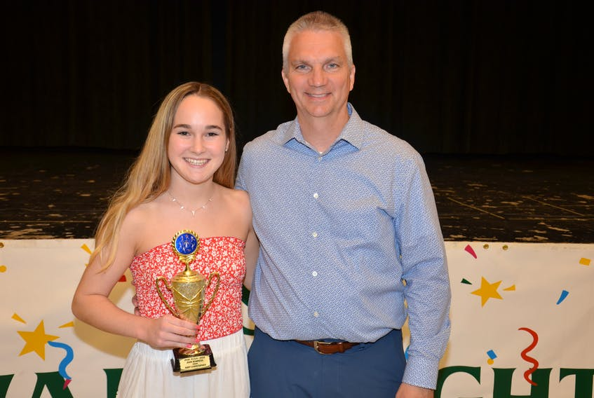 Kensington Intermediate-Senior High School principal and senior A girls' soccer coach Donald Mulligan presents Abby Christopher with the 2018-19 John Bowness Achievement Award. The presentation took place during the school's recent senior awards night.