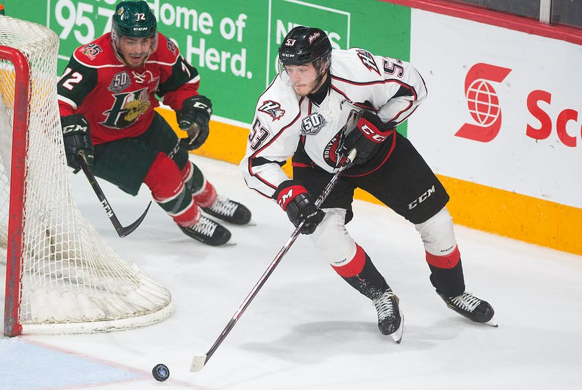 Rouyn-Noranda Huskies defenceman Noah Dobson carries the puck while being chased by the Halifax Mooseheads' Samuel Asselin during Game 6 of the Quebec Major Junior Hockey League championship series at Scotiabank Centre in Halifax, N.S., on May 11.