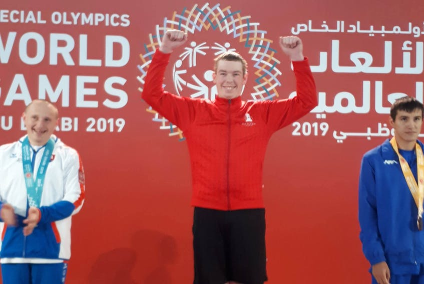 Roy Paynter, centre, stands on the gold-medal podium at the 2019 2019 Special Olympics World Summer Games in Abu Dhabi on Sunday. Paynter, the lone Special Olympics P.E.I. athlete with Team Canada, won gold in the 200-metre freestyle.