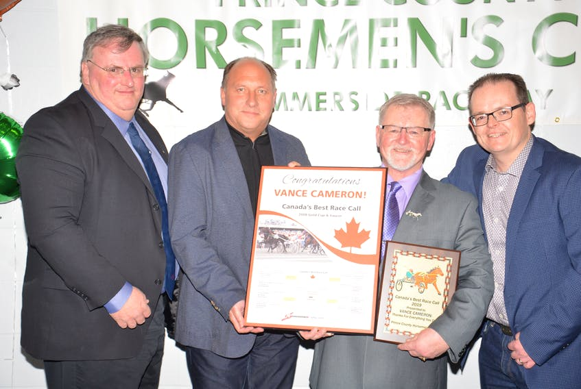 Vance Cameron, second right, of Summerside was recognized for winning Standardbred Canada's Canada's Best Race Call at the recent Prince County Horsemen's Club awards dinner in Summerside. Congratulating Cameron, from left, are Kent Oakes of Standardbred Canada, Lee Drake of Red Shores and Peter MacPhee, a member of the Red Shores' broadcast team.