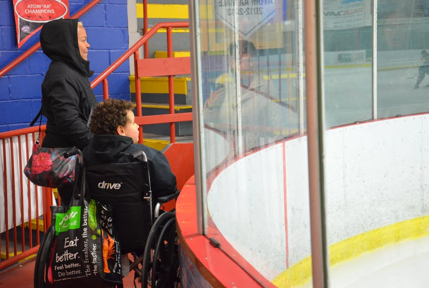 Julien Mondor and his mother, Nathalie Vendrys, watch his Northumberland Bruins' teammates during the bronze-medal game of the second annual Shane Cormier Memorial Meltdown atom A hockey tournament in Kensington recently.