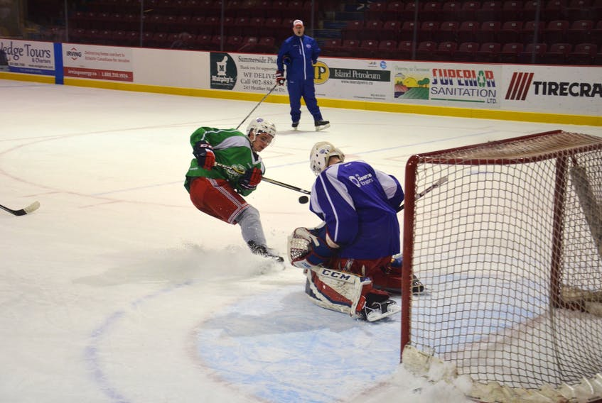 Summerside D. Alex MacDonald Ford Western Capitals' rookie forward Cameron Roberts gets a shot off on goaltender Dominik Tmej while head coach Billy McGuigan looks on during Tuesday afternoon's practice at Eastlink Arena.