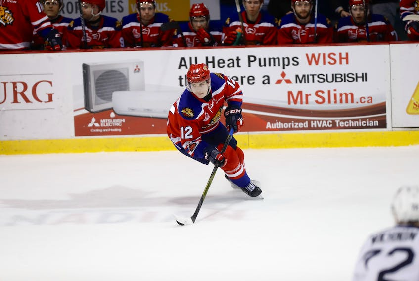 Jeremy McKenna of Summerside controls the puck for the Moncton Wildcats.