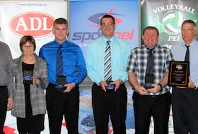 The 1989 Westisle Wolverines' senior boys' volleyball team was inducted into the Volleyball P.E.I. Hall of Fame recently. Volleyball P.E.I. president Brenda Millar, right, congratulates team members in attendance. From left: Lorne and Linda O'Halloran, representing their son, the late Roger O'Halloran, John Ellsworth, Lorne MacKendrick, Glenn Ford and coach Peter Bolo.
