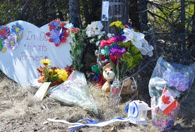People have begun leaving tributes to the victims of the mass killing that began in Portapique. These were left at the top of Portapique Beach Road.