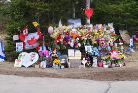 A roadside shrine in Portapi to victims of last week's shooting victims continues to grow.