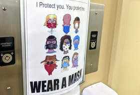 A poster in a Halifax building promotes the use of masks to prevent the spread of COVID-19. - File