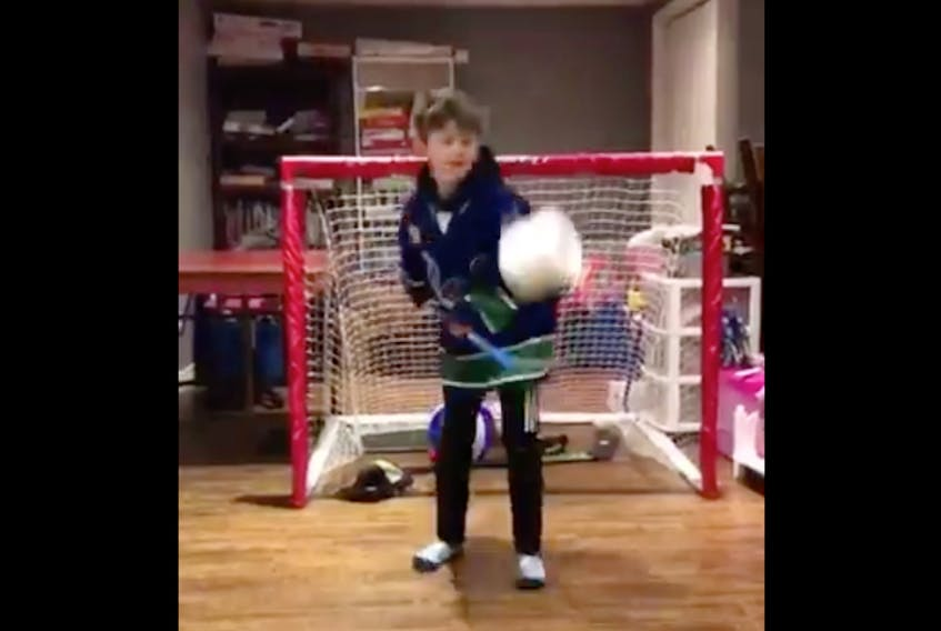 Members of the Paradise atom C minor hockey team used rolled paper instead of vulcanized rubber to display their stickhandling skills to send  a message about the importance of social distancing.