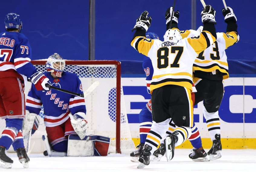 Pittsburgh Penguins captain Sidney Crosby celebrates his game-winning goal against Alexandar Georgiev of the New York Rangers at 2:27 of overtime Saturday at Madison Square Garden. The Penguins defeated the Rangers 5-4. - Bruce Bennett / USA Today Sports
